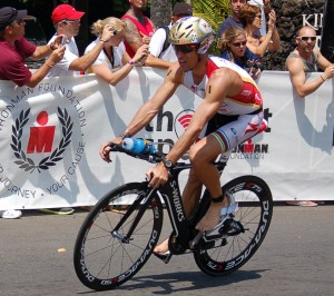 CRAIG ALEXANDER coming in to T2 at Kona 2011